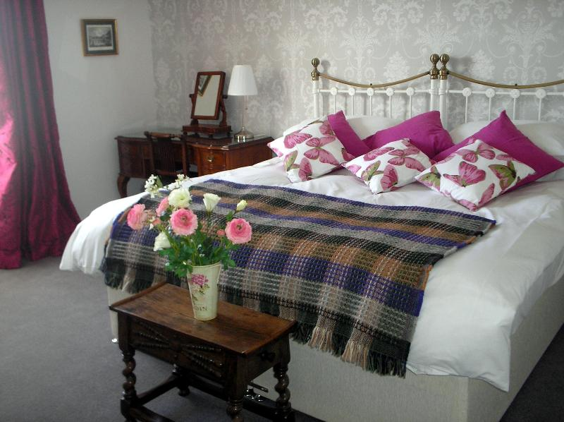 Huge Double Bed,(splits into two Twin Beds if required) with Single Divan Bed to the right.