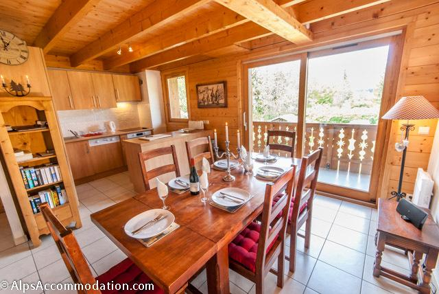Open plan kitchen dining with south facing double balcony access