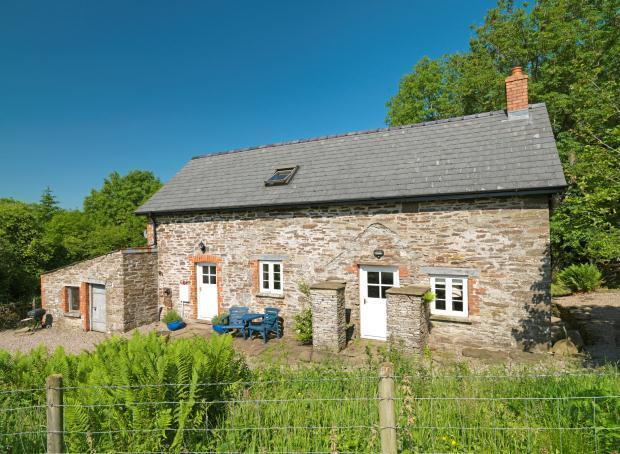 The cottage set in 200 acres of private woodland and stunning mountain views