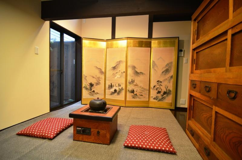 renovated traditional room with 100% natural chemical free walls, antique gold leaf folding screen