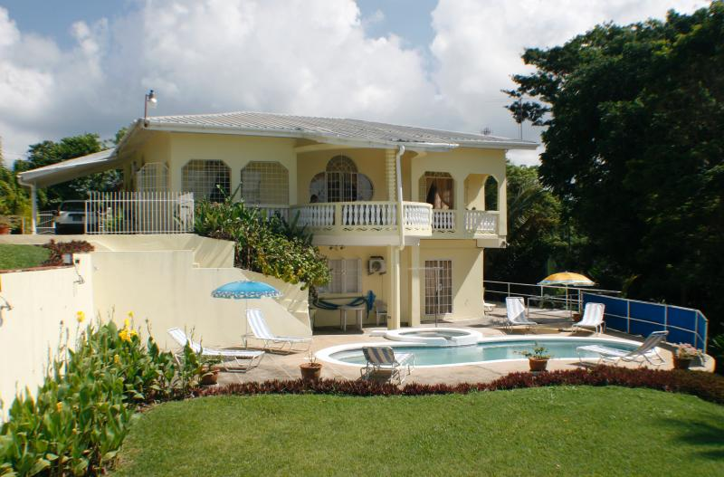 View from the rear of villa showing swimming pool..... Wouldn't you like to be lazing here?