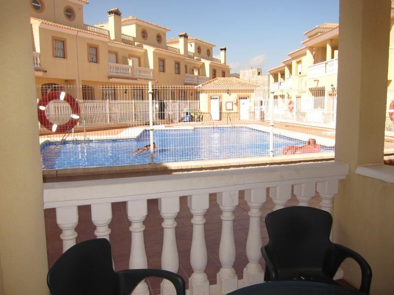 View from private sitting area overlooking pool. Enjoy a cooling drink whilst watching others swim