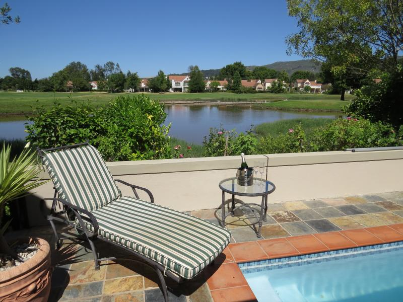 Villa view overlooking fairway water feature with mountain backdrop
