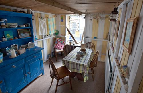 Beach hut themed Dinning room ,complete with bucket and spades