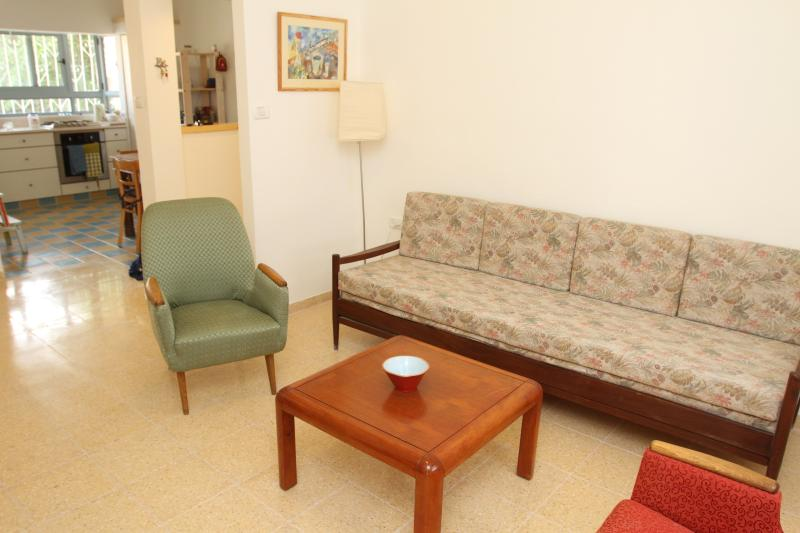 living room, full of light, sofa and armchairs, cable TV, DVD and WiFi, exit to a balcony