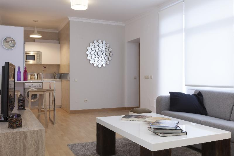 Living room includes TV with wide selection of movies and music available at your leisure.