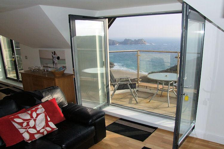 Views of Porthcurno beach from the living area
