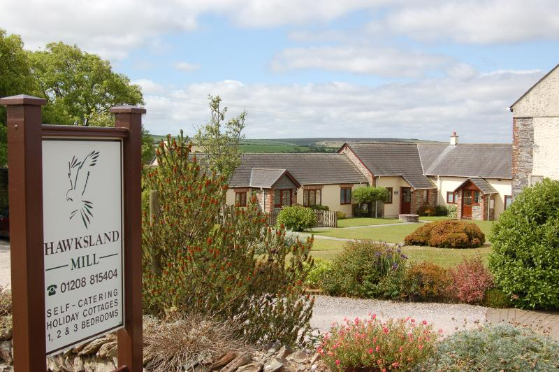 Hawksland Mill courtyard set in rolling Cornish countryside with ample parking