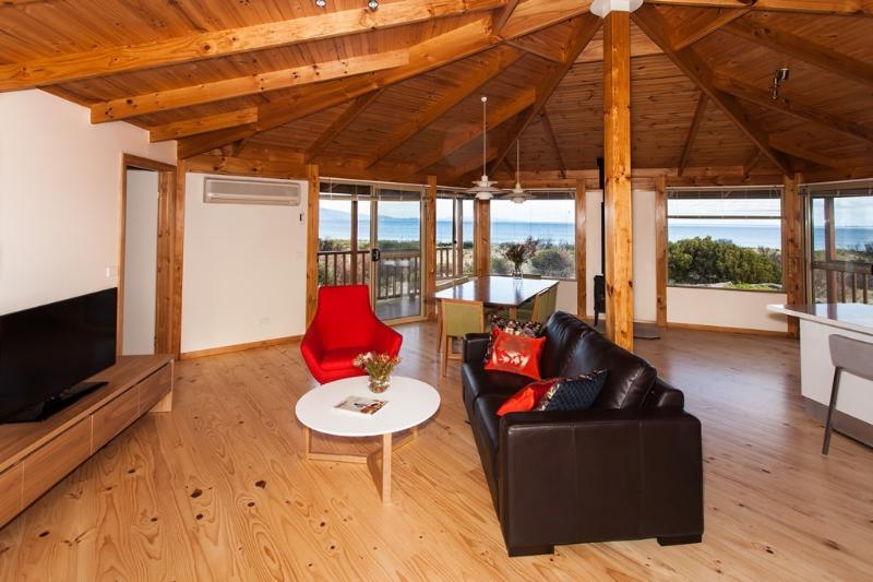 Living area with high quality furniture and panoramic views over Great Oyster Bay