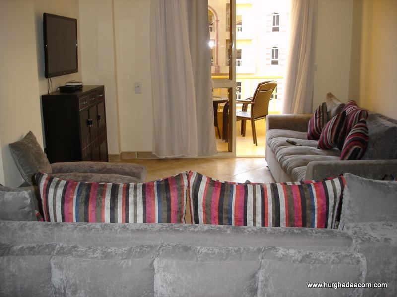 Bright and spacious lounge with 42'' LED HD Sat TV, leading to sunny balcony overlooking t