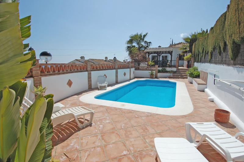 Traditional terracotta tiling around private pool