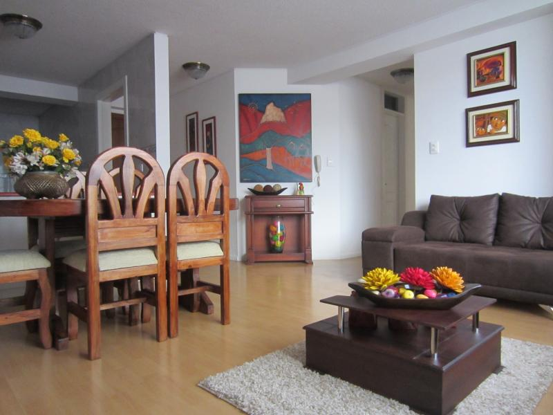 Living room with modern furniture and traditional decoration.