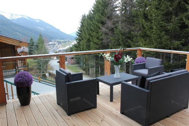 Stunning views from private elevated balcony summer and winter