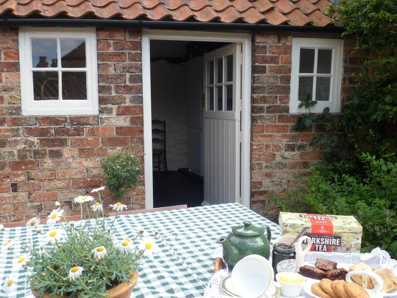 The Court yard with lockable out-house. A duck returns each year to raise her young under the window