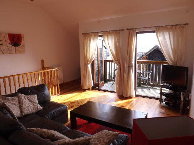 Large comfortable lounge with great views over harbour and Mounts Bay.