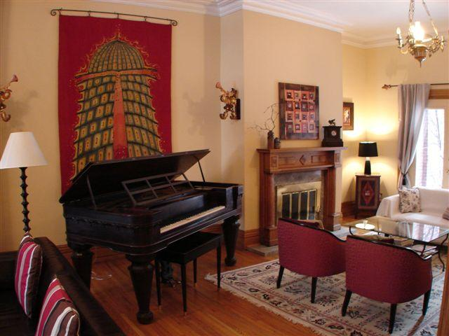 living room with 1850 Chickering piano and second fireplace