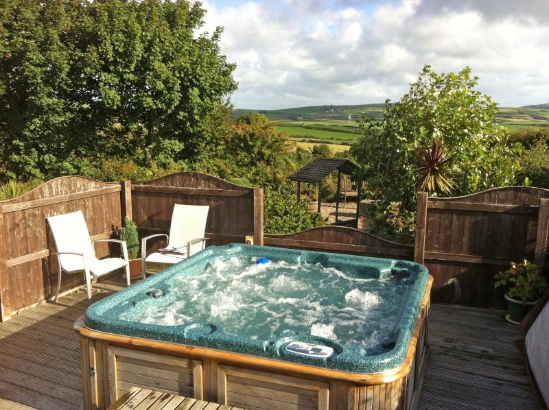 Relax in the hot tub with fantastic countryside views