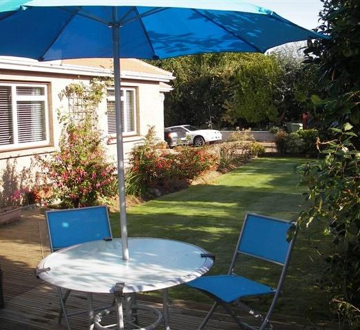 The garden with furniture and grass area is lovely for sunny days