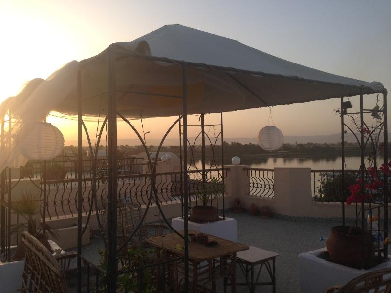 Our private roof terrace at sunset with breathtaking views of The Valley Of The Kings And The Nile