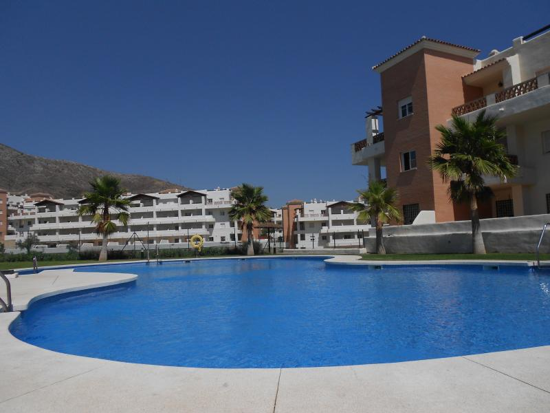 Swimming  Pool next to the apartment with wonderfull Mountain Views and area's to relax