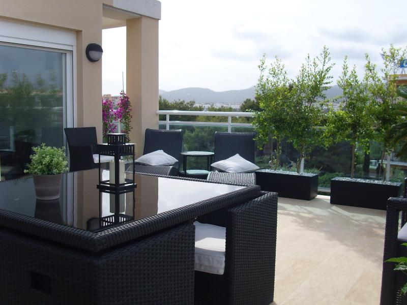 Terrace with a private garden. Beautiful views to the mountain and sunset.