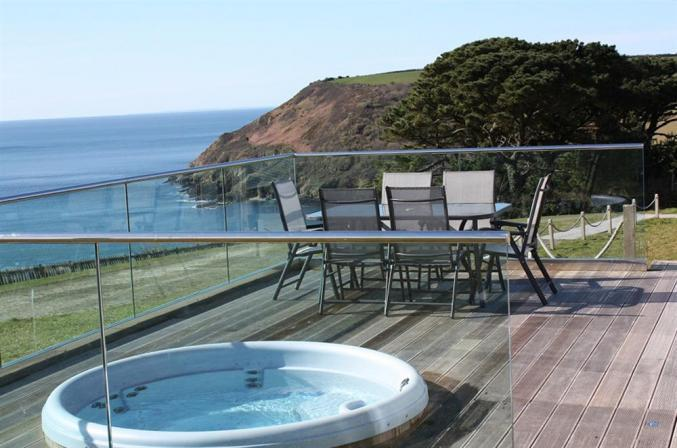 Hot tub & Outdoor seating with amazing views over Talland Bay