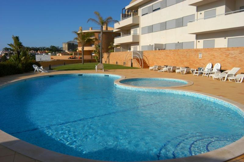 Large pool with kiddies paddling pool - also plenty of sunloungers