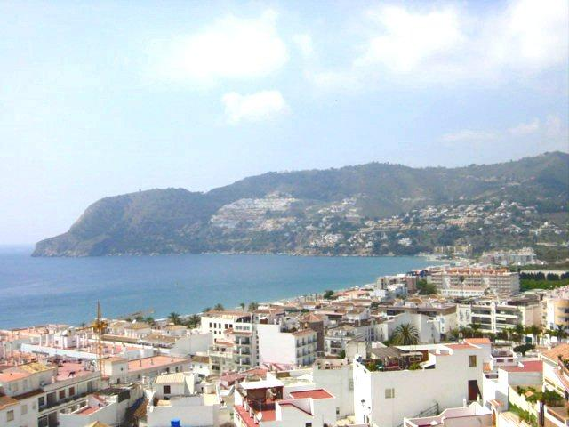View from Apartment Balcony into the Village and to the Bay