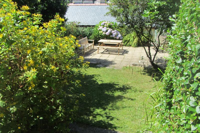 The sunny, private garden/terrace. Ideal for family barbecues and sunbathing