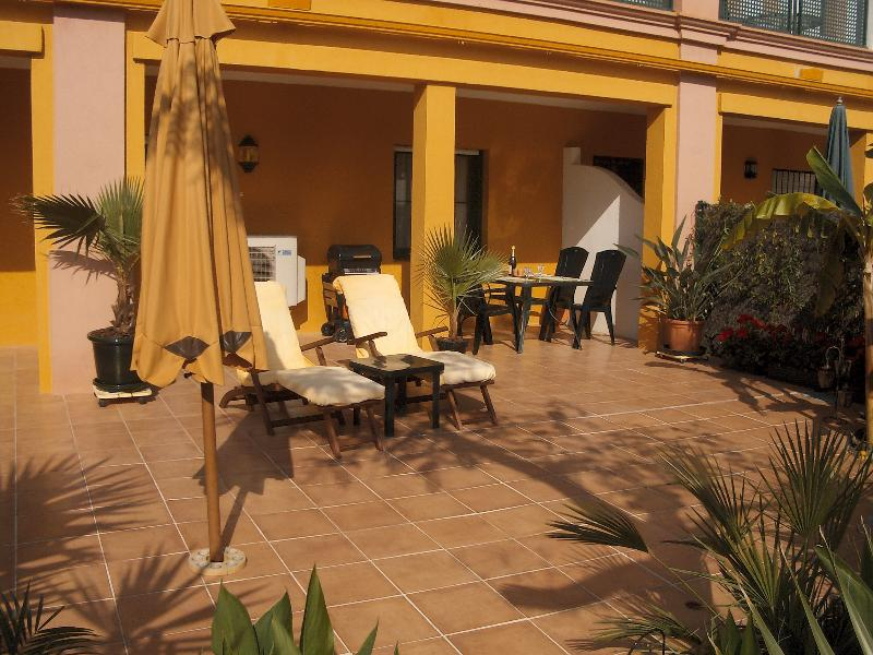 The Large Terrace with Outside Dining, BBQ Sunbeds, Parasol and small Private Garden