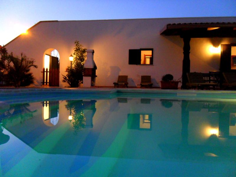 Warm balmy evenings beside the illuminated pool waters