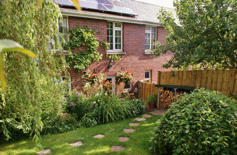 Back of house showing part of garden and solar panels
