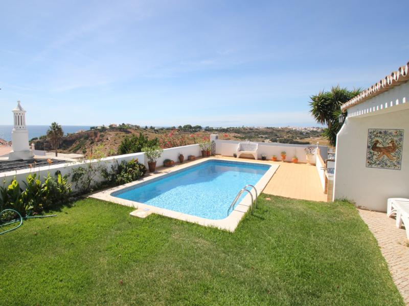 pool and garden with fabulous sea views