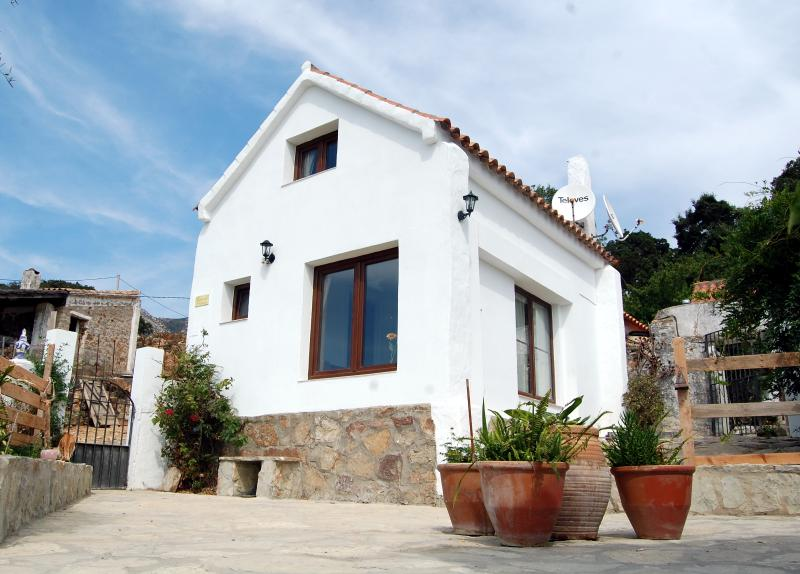 The traditional andalusian courtyard with our white cottage.