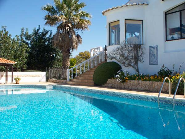 Side of villa with beautiful pool & stunning views.