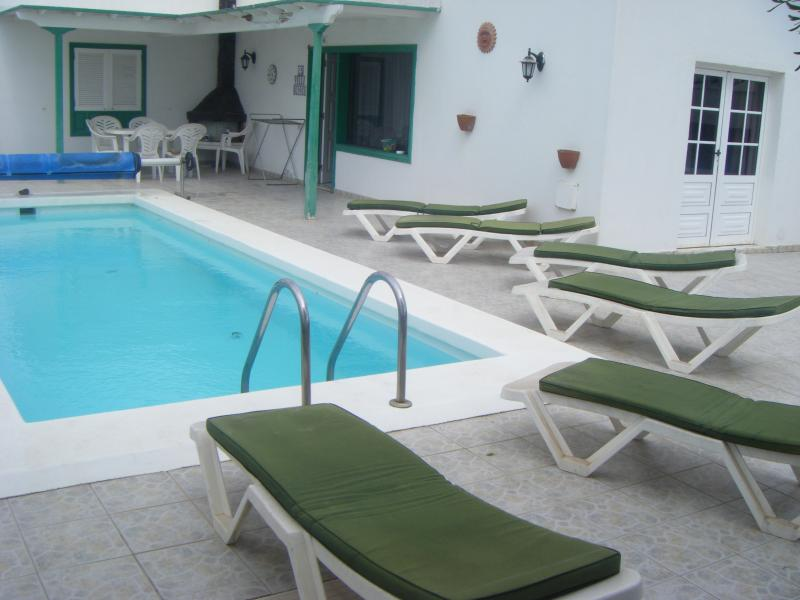 view of pool and  villa solar heated pool