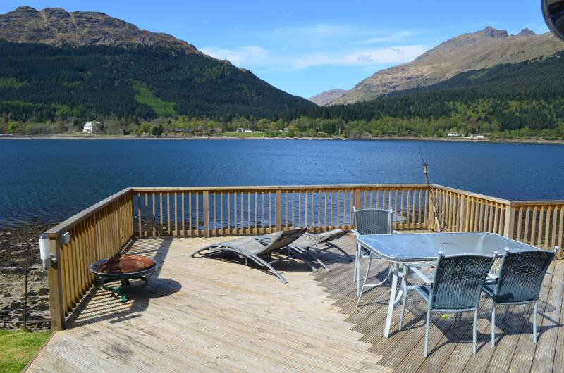 Deck area overlooking Loch Long, direct beach access ! use of boat for fishing