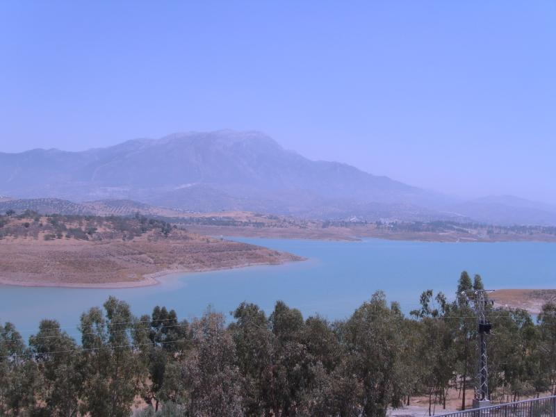 Stunning Lake Vinuela with Mount Maroma in distance