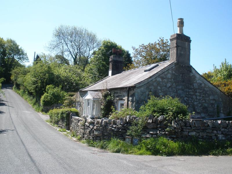 Grade II listed slate worker's cottage with 0.2 acre garden and parking