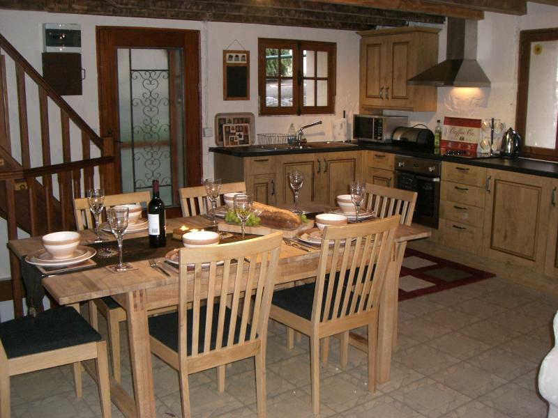 new fully equipt kitchen / dining room table seats 8