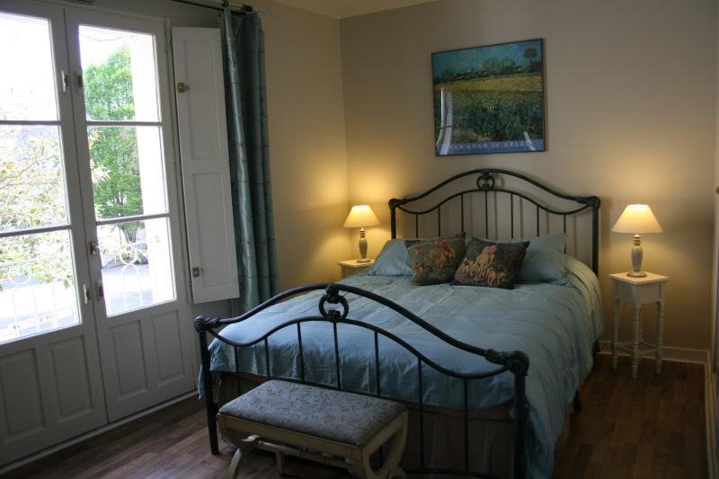 Bedroom features oversized double bed with down comforter.