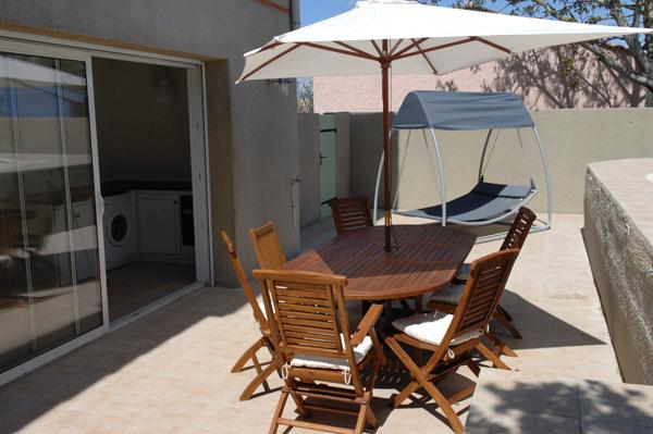 Maison du Midi has two beautiful private terraces. This one has a wooden table with six chairs under