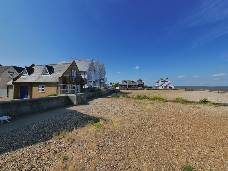 View of cottage from the beach, local pub in the background !