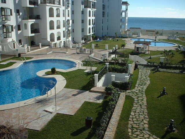 pools, landscaped garden and beach