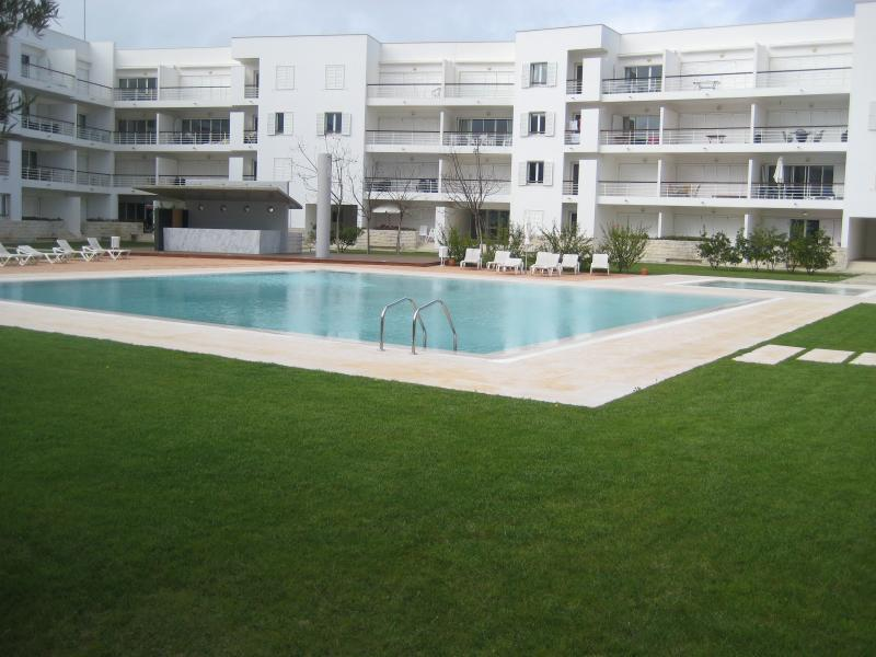 Main Pool and children's pool. Garden area.