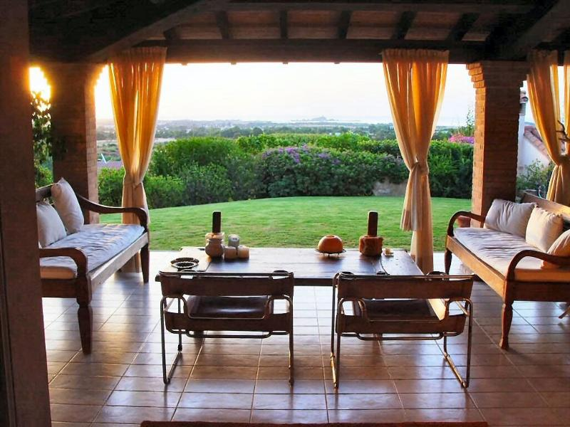 The living room leads to the beautiful veranda and to the rich garden