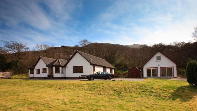 Wildwood Farmhouse from the large garden with games room with table tennis and pool tables.