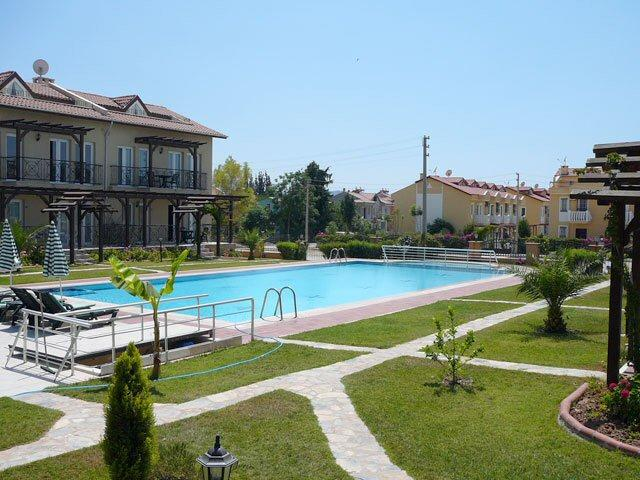 View of gardens and pool from the terrace ideal for relaxing evening drinks