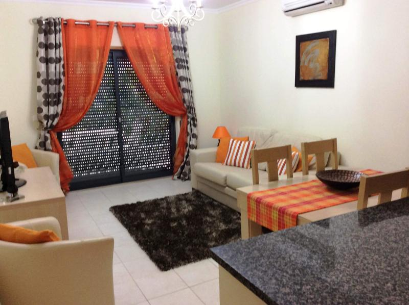 Modern well decorated lounge with terrace, air con and plasma TV