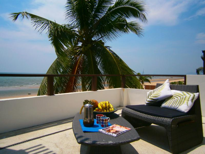 Enjoy breakfast on the balcony off the master bedroom, palm tree waving, with views over the ocean